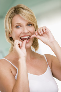 bigstock-Woman-Flossing-Teeth-4135470